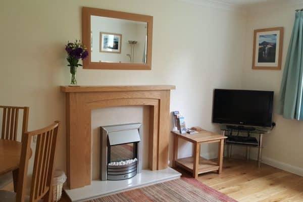 Riverside View Lounge keswick Cottage